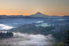 Foggy Sunrise Over Sandy River and Mount Hood. Foggy Sunrise Over Sandy River Valley and Mount Hood in Oregon royalty free stock photos