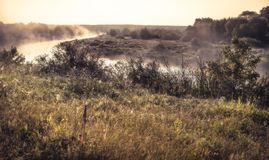 Foggy sunrise rustic countryside scenery landscape with fog river during summer. Morning royalty free stock image