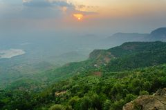 A foggy sunset at Lady`s Seat, Yercaud. A foggy sunset beyond the mountains at Lady`s Seat overlooking the Salem town and Ghat road, Yercaud, Tamil Nadu Stock Image
