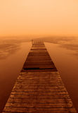 Foggy sunset on the boardwalk Royalty Free Stock Photo