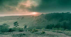 A foggy sunset at Mottistone Common, Isle of Wight. Turneresque Sunset at Mottistone Common, Isle of Wight Stock Photo