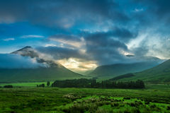 Foggy sunset over the mountains of Glencoe in Scotland stock photos