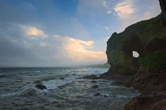 Foggy sunset at the stormy sea. Stock Photography