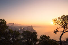 Foggy sunset royalty free stock images