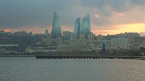 Foggy sunset with view of the flame towers. Baku, Azerbaijan stock footage