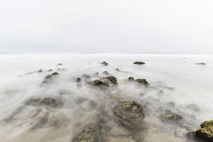 Foggy Tidal Pool with Motion Blur in Malibu California. Foggy pacific ocean tidal pool with motion blur at Point Dume in Malibu California Royalty Free Stock Image