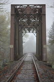 Foggy Train Bridge. Perspective photo of train tracks and bridge taken on a foggy day Royalty Free Stock Photo