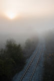 Foggy train rail scenery Royalty Free Stock Photos