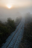 Foggy train rail scenery Stock Photos