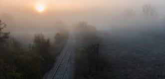 Foggy train rail scenery Stock Photography
