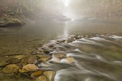 Foggy Tranquility at Blue Hole Royalty Free Stock Image