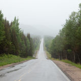 Foggy Trans-Labrador Highway TLH Quebec Canada. Rain and fog over Trans-Labrador Highway in Quebec, Canada. This remote road connects over more than 1100 km royalty free stock photo