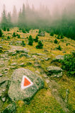 Foggy Transylvanian mountain tracking. Red triangle guide on Foggy Transylvanian mountain tracking stock photography