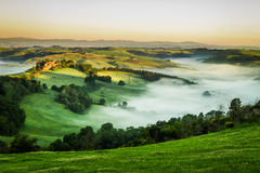 Foggy Valley in the morning, Tuscany Royalty Free Stock Photo