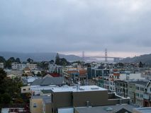 Foggy view of Golden Gate Bridge and Marin Headlands from west side of city stock images