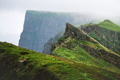 Foggy view of gorgeous mountains of Mykines island