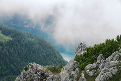 Foggy view on the Koenigssee from the mountain Jenner. Beautiful foggy view on the Koenigssee and forest  from Jenner mountain, a peak in Berchtesgaden, Germany Royalty Free Stock Photo