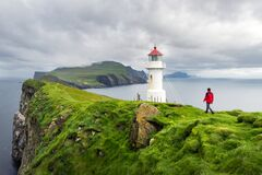 Free Foggy View Of Old Lighthouse On The Mykines Island Royalty Free Stock Photos - 214240748