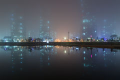Foggy view of skyscrapers and reflection in Incheon at dusk