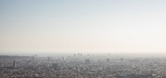 Foggy views of the city of Barcelona and the Mediterranean sea. With copy space royalty free stock photography