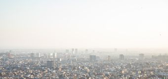 Foggy views of the city of Barcelona and the Mediterranean sea. With copy space stock photography
