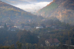 Foggy Village in Balkan Mountains Royalty Free Stock Images
