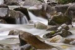 Foggy water. Water running down the rocks Stock Images