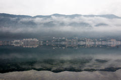 Foggy weater on the sea with mountain reflections Royalty Free Stock Photo