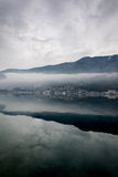 Foggy weater on the sea with mountain reflections Royalty Free Stock Photography