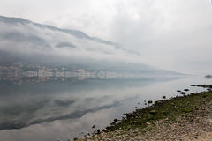 Foggy weater on the sea with mountain reflections Royalty Free Stock Photos