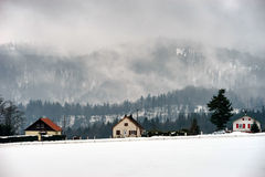 Foggy weather in high mountains, winter Royalty Free Stock Photo