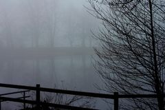 Mist on a pond in winter stock image