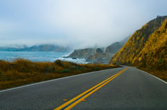 Foggy winding road Stock Photo