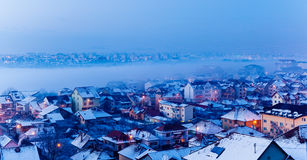 Foggy winter, city landscape. With snow royalty free stock photography