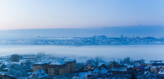 Foggy winter, city landscape with snow Stock Images