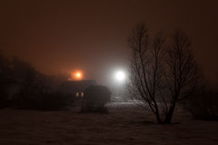 Foggy winter evening in the village Stock Photography
