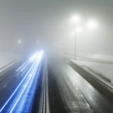 Foggy winter highway. Foggy winter night on the highway in the night the light of lanterns. Rosiiya, Moscow royalty free stock photos