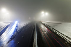 Foggy winter highway. Foggy winter night on the highway in the night the light of lanterns. Rosiiya, Moscow stock photos