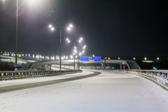 Foggy winter highway. Foggy winter night on the highway in the night the light of lanterns. Russia, Moscow stock photo