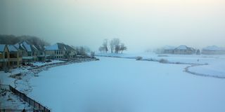 Foggy winter morning on a frozen golf course. Royalty Free Stock Image