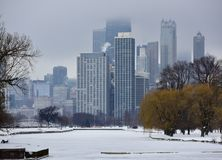 Foggy Winter Morning. This is a Winter picture of a foggy morning over the Chicago skyline as seen looking over the frozen snow covered Lincoln spark Lagoon Stock Photography