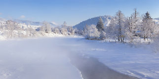 Foggy winter panorama of mountain village Stock Images