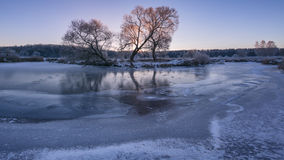 Winter sunrise. Lake with ice Royalty Free Stock Images