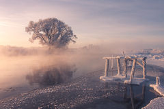 Frozen river. Winter fog on river Royalty Free Stock Image
