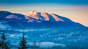 Foggy Zakopane and lighted peak at dawn in winter, Tatra Mountains Royalty Free Stock Photography