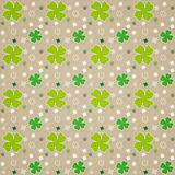 Fogli di verde su Brown Immagine Stock