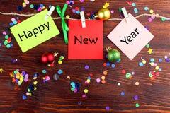 Foglie della carta con il buon anno di parole Immagini Stock Libere da Diritti