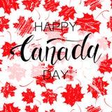 Foglie di acero e testo rossi di giorno del Canada Fotografie Stock