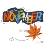 Foglie di autunno e parola novembre di tipografia Fotografie Stock