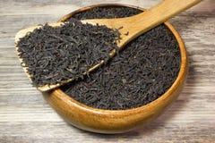 Foglie di tè asciutte per tè nero Immagine Stock